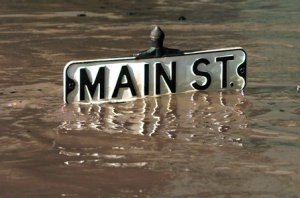 FLOOD WATERS AROUND STREET SIGN
